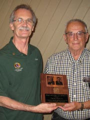 Gary Colton, left, presents Frank Bartzen with the