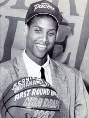 Reggie Miller smiles after receiving a basketball as