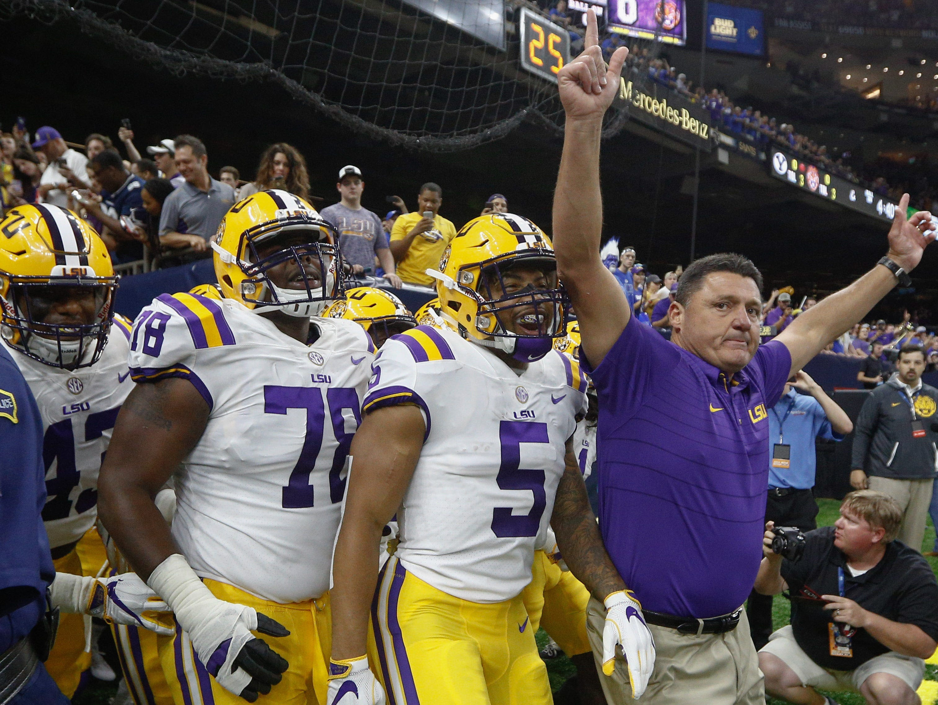 Sep 2, 2017; New Orleans, LA, USA; LSU Tigers head coach Ed Orgeron leads his team onto the field before the AdvoCare Texas Kickoff game against the Brigham Young Cougars at the Mercedes-Benz Superdome. Mandatory Credit: Derick E. Hingle-USA TODAY Sports