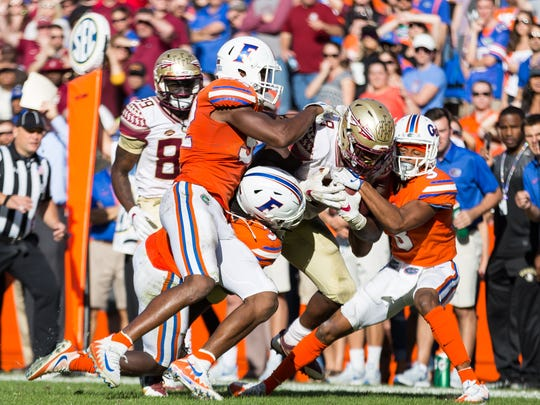 Junior running back Jacques Patrick (9) rushed for 67 yards  as FSU continues their five year winning streak against Florida by a score of 38-22 at Ben Hill Griffin Stadium in Gainesville Fl on Nov. 25th, 2017.