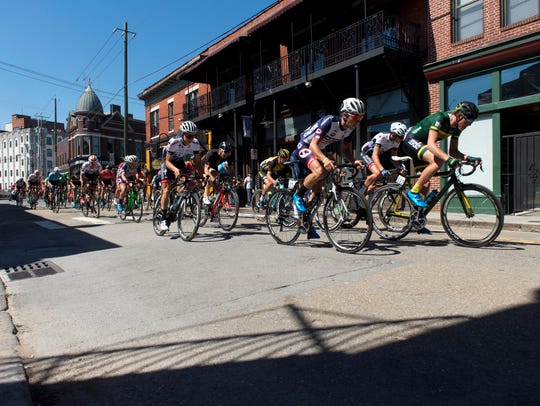 Cyclists ride through the Old City during the USA Cycling