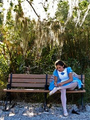 Julia Hajjar, 15, tends to her ballerina shoes while taking part in the Boo at the Zoo event at Naples Zoo & Caribbean Gardens. Hajjar has performed in several Miami Ballet presentations of the Nutcracker at Artis Naples.