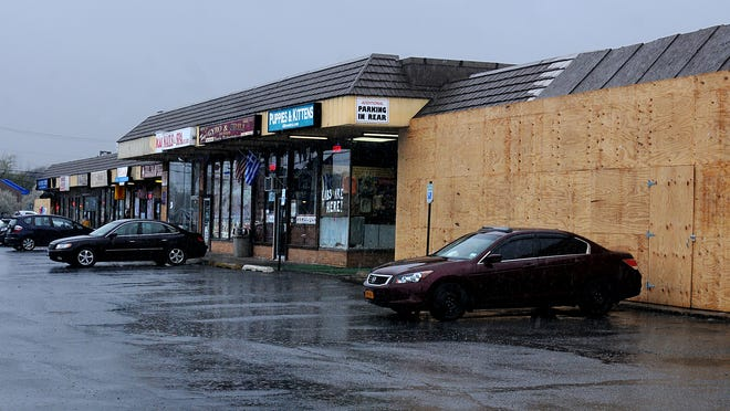 This is the south end of the Dutchess Shopping Plaza on Route 9 in Wappingers Falls. Both ends of the complex have former store fronts boarded up after separate fires destroyed the retail space.