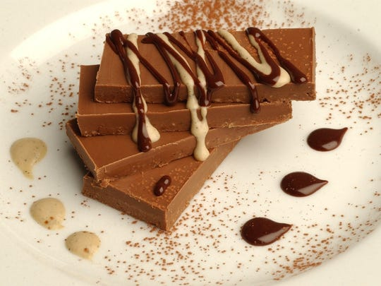 One of Brian Polcyn's dessert recipes is Gianduja Chocolate Bars with Espresso Sauce.