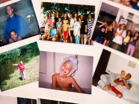 Photos on a memorial board show Ty Sawyer throughout his life.