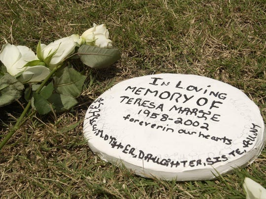 A memorial to Teresa Wren Gilcrease was placed in the spot where her body was found on June 10, 2002.