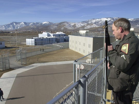 A corrections officer watches over the yard at Warm Springs Correctional Center near Carson City in 2001.