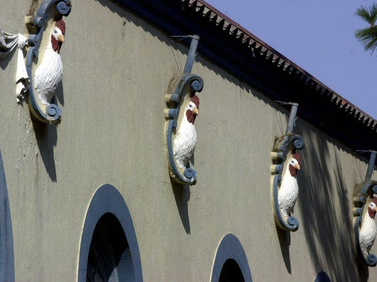 """The Poultry Building, built in 1921, is known for the """"chicken head"""" sculptures."""