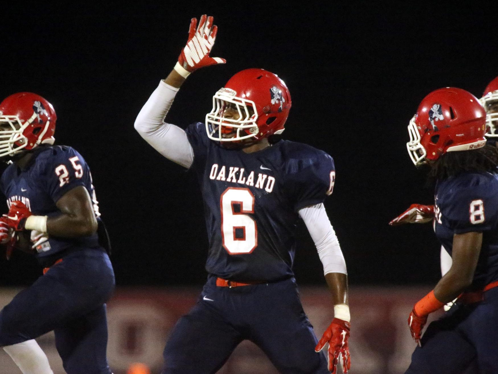 Oakland's Kaleb Oliver (6) celebrates making an interception during the game against Blackman at Oakland, on Friday Sept. 18, 2015.
