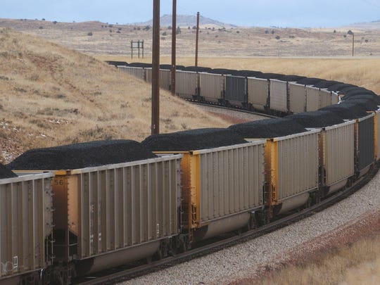A trainload of coal from the Spring Creek Mine heads south through Decker in this Tribune File Photo.