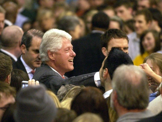 Former President Bill Clinton shakes people's hands after his speech as the Lancaster High School gymnasium Feb. 25, 2008, while campaigning for his wife, Hillary Clinton.