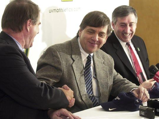 University of Vermont President Daniel Fogel, left, Hockey East commissioner Joe Bertagna, center, and UVM athletic director Bob Corran announce the school's move to Hockey East in 2004.