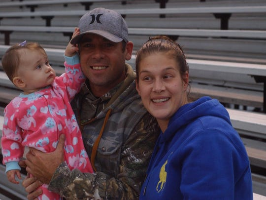 Indians fans Brian and Lauren Mawyer with their daughter Skylar at Fort Defiance's football game against Turner Ashby on Oct. 7 at Fort Defiance.