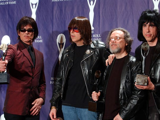 In this March 18, 2002, file photo, members of the Ramones, from left to right, Dee Dee, Johnny, Tommy and Marky Ramone hold their awards after being inducted at the Rock and Roll Hall of Fame induction ceremony at New York's Waldorf Astoria. A business associate says Tommy, the last surviving member of the original group, has died. Dave Frey, who works for Ramones Productions and Silent Partner Management, confirmed that he died on Friday, July 11, 2014. Ramone was 65.