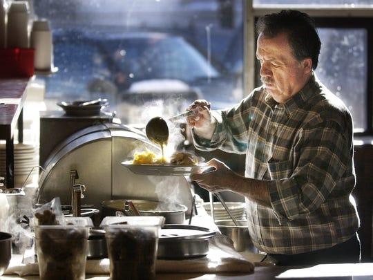 Nectar Rorris serves up lunch at his Main Street establishment,