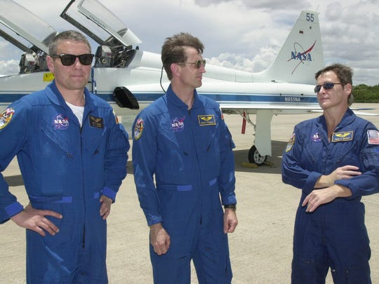 Peggy Whitson and Russian cosmonauts Valery Korzun, left, and Sergei Treschev arrive at Kennedy Space Center in Cape Canaveral, Fla., in 2002, a few days before launch.
