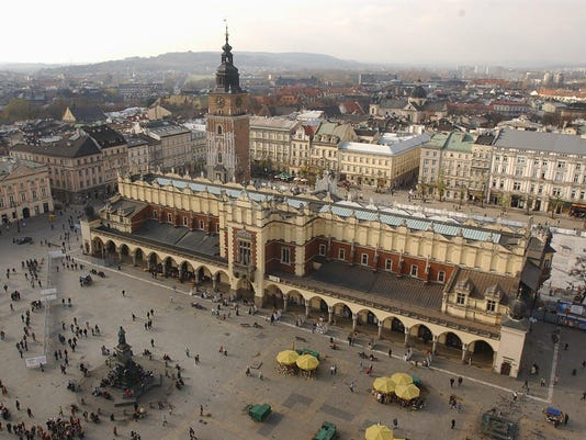 FILE - In this file photo taken on Nov. 3, 2004,  is seen the Cloth Market in the Renaissance Market Square in the historic city of Krakow, Poland. The city mayor, Jacek Majchrowski, on Monday cancelled its bid for the 2022 Winter Games, after residents overwhelmingly voted against in a local referendum held on Sunday, May 25, 2014. (AP Photo/Czarek Sokolowski, file)