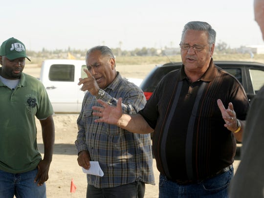 Dennis Sutherland, right, lead Pastor at Bethel Family Worship Center in Tulare, and a group of parishioners pray for a solution to their problem and for the Tulare City Council to make the right decisions, south of Cartmill Avenue and north of the Tulare Outlet Center, along Retherford Street. Also pictured is Ray Russell, left, and Porfirio Venegas, center.