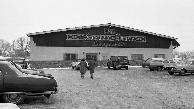 Exterior shot of the Sveden House Smorgasbord and parking lot, Jan. 18, 1968.