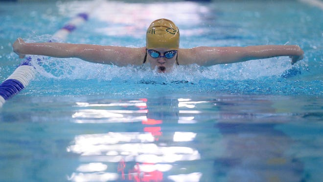 C.M. Russell High's Olivia Bauman is the girls' Athlete of the Week.