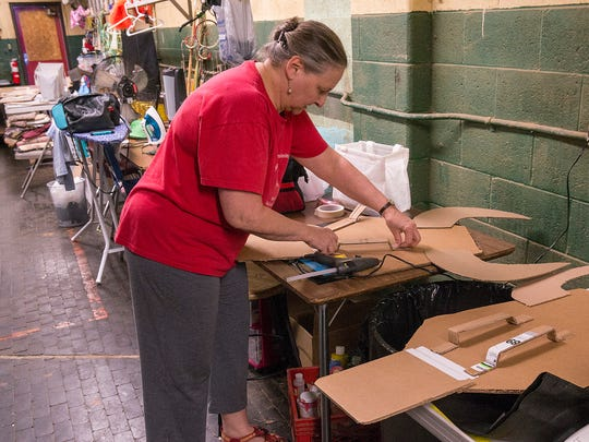 Nancy Koppin works on masks for the Lion King production by Forever After Productions.