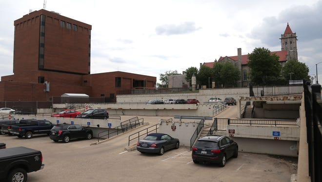 The Mansfield Police Department is looking at renovating the parking facility north of city hall into a shooting range.