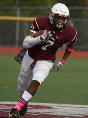 Aquinas's Caron Robinson carries the ball for several
