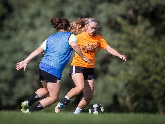 Bailee Allen practices drills during a Delta practice