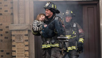 """Taylor Kinney, left, as Kelly Severide, Randy Flagler as Capp in a scene from """"Chicago Fire"""" on NBC."""