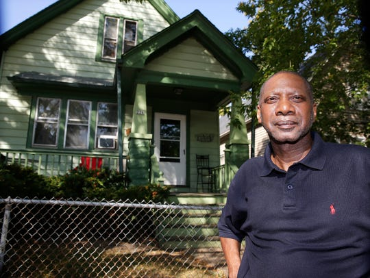 Robert Yorker stands in front of his home on E. Chambers