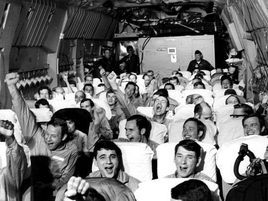 Newly freed prisoners of war celebrate as their C-141A aircraft lifts off from Hanoi, North Vietnam, on Feb. 12, 1973, during Operation Homecoming. The mission included 54 C-141 flights between Feb. 12 and April 4, 1973, returning 591 POWs to American soil.