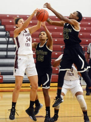 Tereza Sedlakova of Florida Tech fights for a rebound with Deslyn Applewhaite of Webber during a 2015 game in Melbourne.