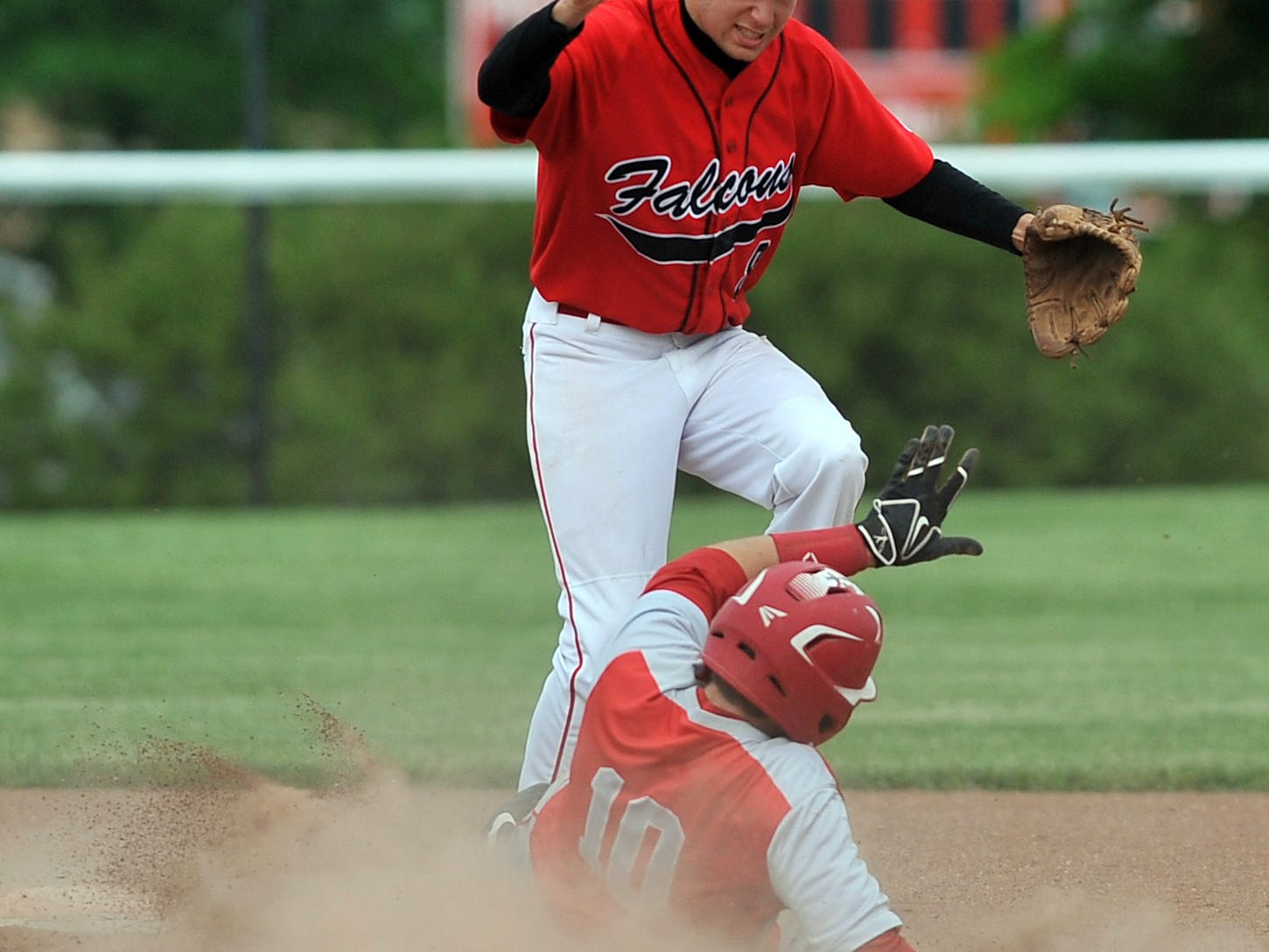 Fairfield Union second baseman Brandon Wallace tries to get out of the way of the slide of Sheridan's Collin Conrad Thursday at Fairfield Union High School in Rushville. The Falcons lost 3-2 to the Generals in eight innings.