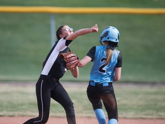 Cedar High School's Allie Meisner tags a Canyon View