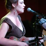 "Jillian Johnson sings and plays at Grant Street Dancehall in this 2010 photo. Johnson's music will be part of a forthcoming CD, ""Lafayette Healing."""