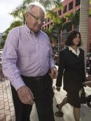 Robert and Kay Gow, seen following arraignment in U.S. District Court in Fort Myers on money laundering and fraud changes last March, are due for trial in April.  They were charged in connection with a $4.7 million economic development grant from Lee County that did not produce promised jobs.