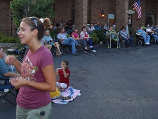 A large gathering of residents and visitors anxiously