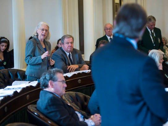 Sen. Peg Flory, R-Rutland, left, interrogates Sen.