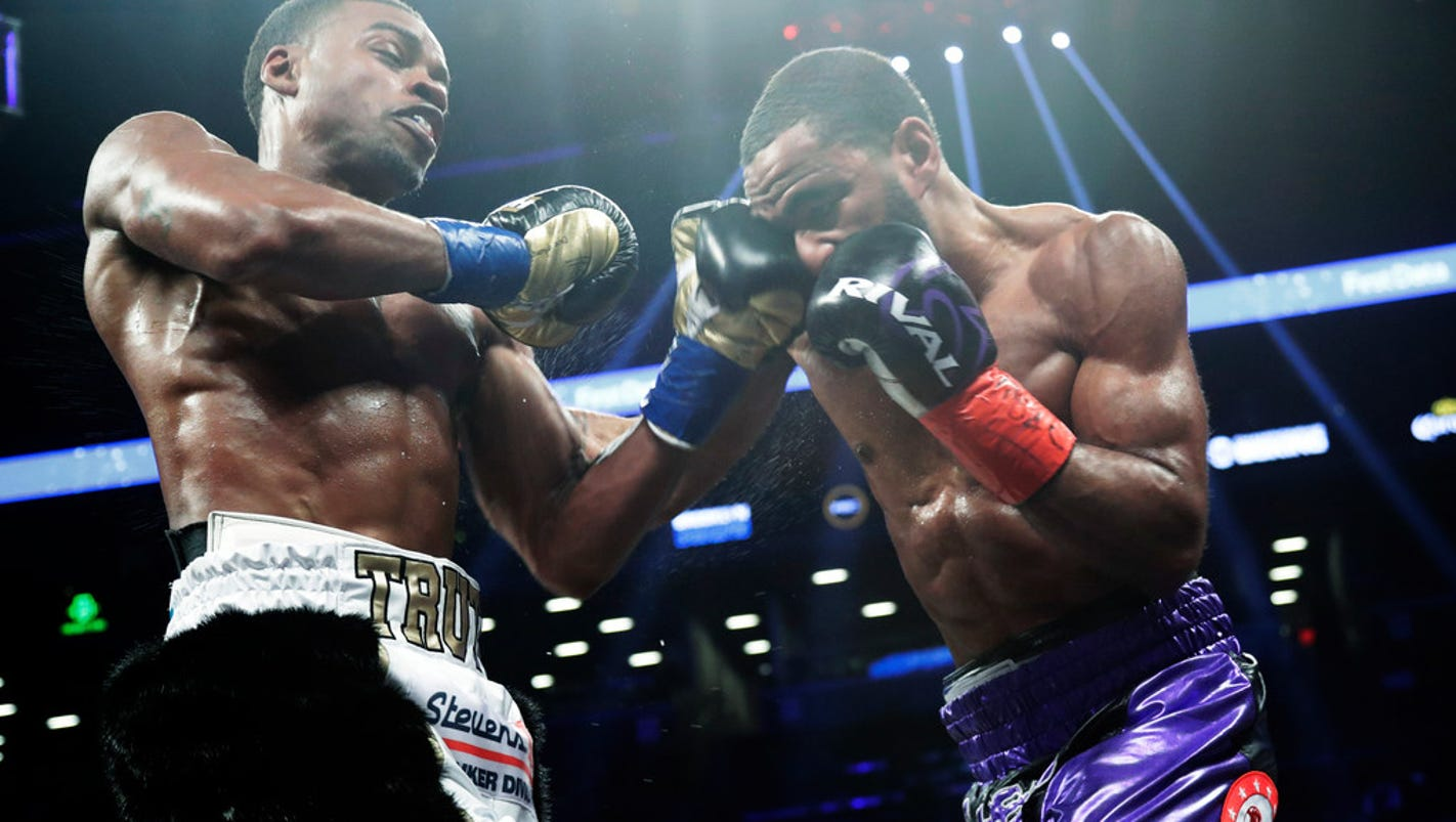 Errol Spence Jr. stops Lamont Peterson in eighth round to retain welterweight title
