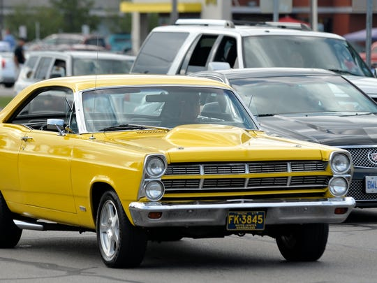 This yellow 1967 Ford Fairlane GTA travels northbound near 13 Mile Rd.  (Todd McInturf, The Detroit News)2017.