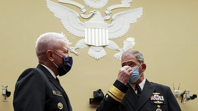 U.S. Assistant Secretary for Health Admiral Brett P. Giroir speaks with Pentagon Supply Chain Stabilization Task Force Vice Director of Logistics Rear Admiral John Polowczyk at the start of a House Select Subcommittee on the Coronavirus Crisis hearing on July 2, 2020 in Washington, DC.