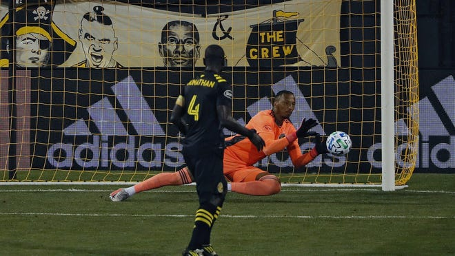 Crew goalkeeper Eloy Room makes a save during a 1-0 victory over the Philadelphia Union on Wednesday.