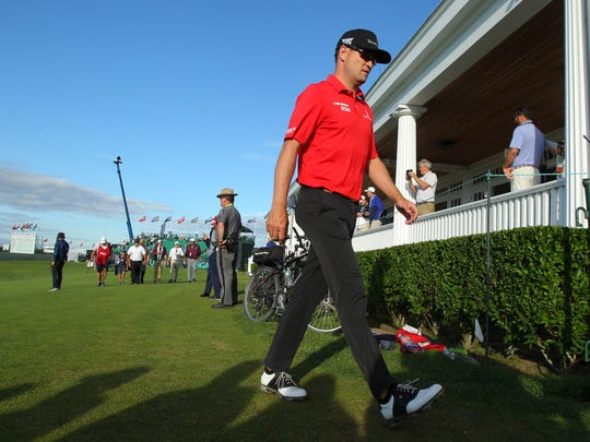 Zach Johnson walks off the course after completing