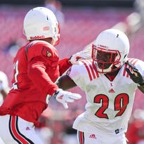 Louisville cornerback Trumaine Washington, right, will be called upon to get more action in the 2015 season. He appeared in eight games in 2014.