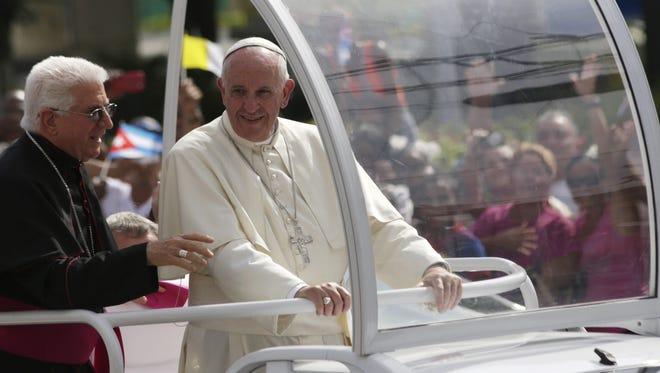 Pope Francis rides through Santiago de Cuba in eastern Cuba on Sept. 22, 2015.
