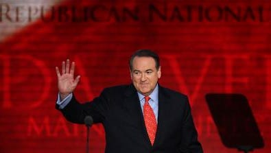 Former Arkansas Gov. Mike Huckabee waves while taking the stage during the third day of the Republican National Convention at the Tampa Bay Times Forum on August 29, 2012 in Tampa, Florida. Former Massachusetts Gov. Mitt Romney was nominated as the Republican presidential candidate during the RNC, which is scheduled to conclude August 30.