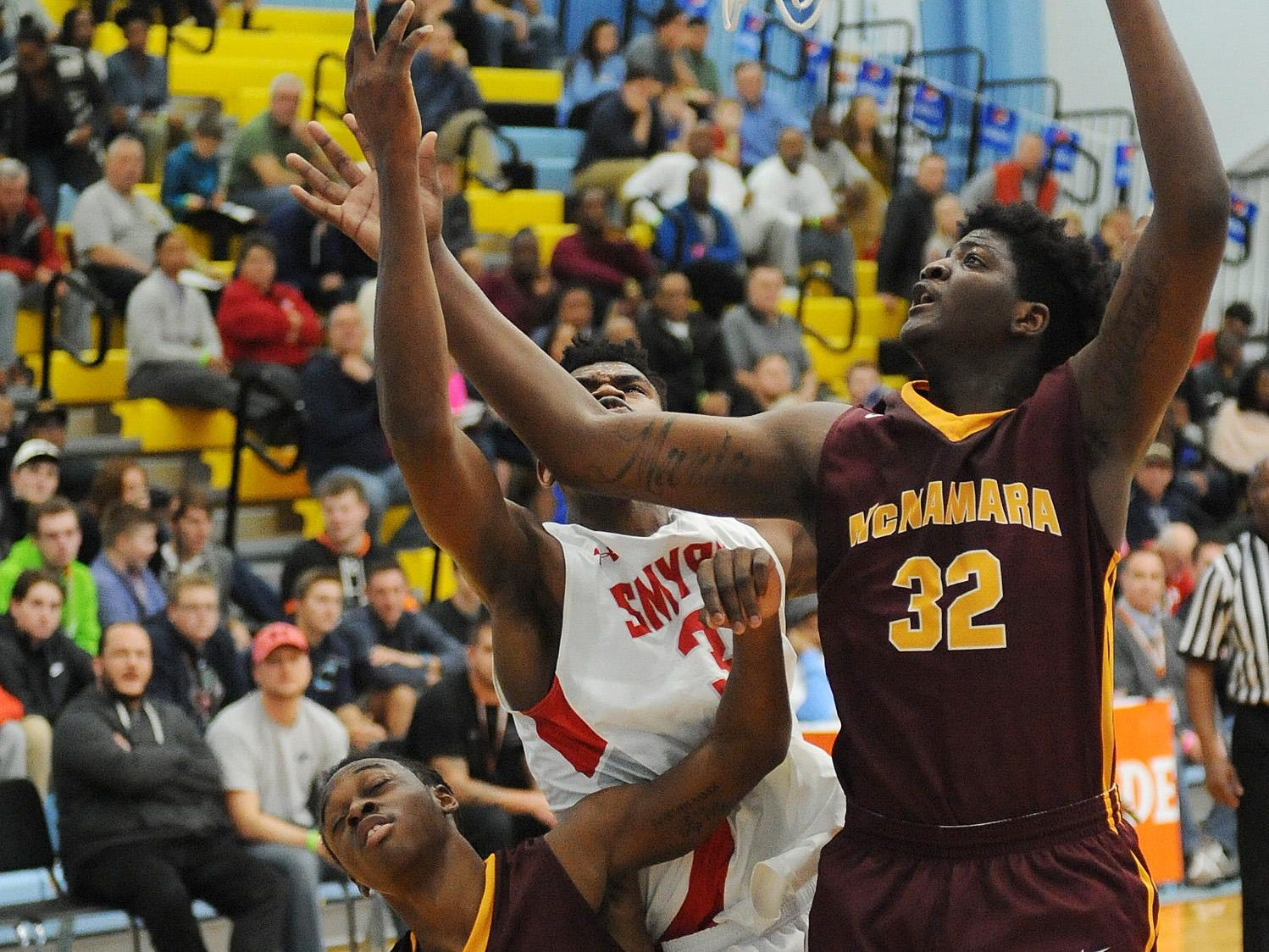 The Annual Slam Dunk to the Beach Basketball Tournament started at Cape Henlopen High School in Lewes on Tuesday December 27th with Smyrna HS (white) hosting Bishop McNamara HS from Forestville, Md.