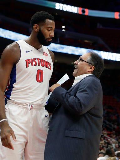 Detroit Pistons head coach Stan Van Gundy, right, talks