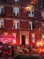 Firefighters used ladders to rescue eight residents