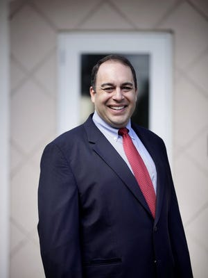 Naples City Councilman Sam Saad III poses for a portrait in front of the building he purchased for his firm, which focuses on the protection of business and real estate interests of clients, on Oct. 31, 2014, in Naples, Fla. He plans to be operating from the 8,700-square-foot building on 2670 Airport-Pulling Road South on Dec. 15.
